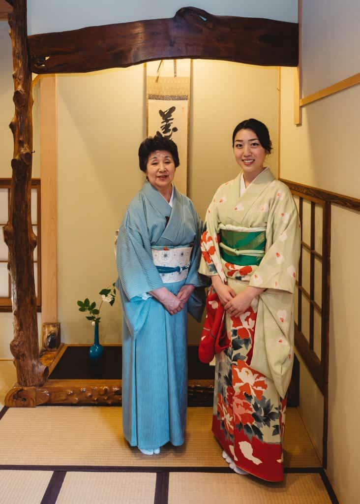 two women in kimono in tea room