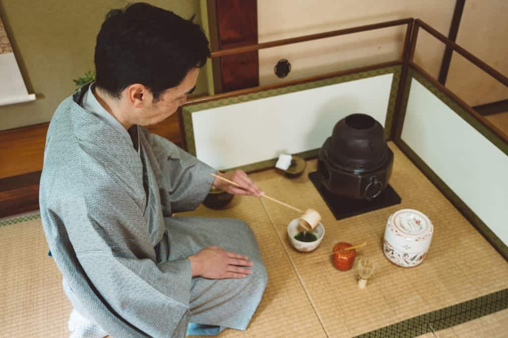 man practicing tea ceremony