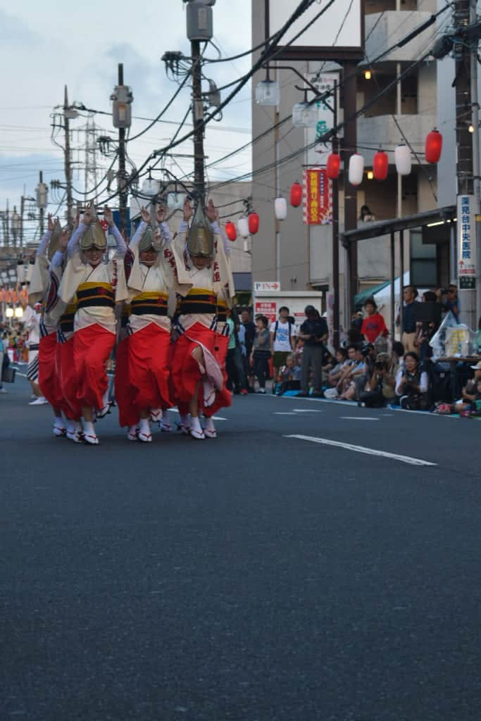 awa odori dancers coming down the street