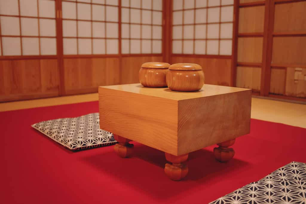 a traditional japanese go board with legs in the honinbo shusaku museum