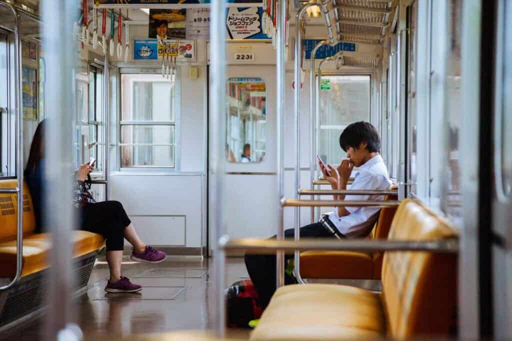 boy on japanese train with phone