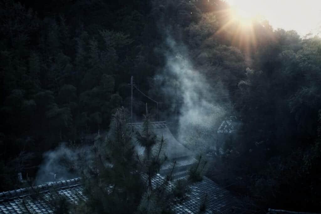 Smoke rising between traditional houses in Sagatoriimoto