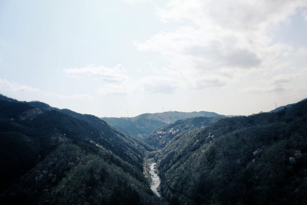 A view of Hozukyo Gorge on a sunny day near Arashiyama