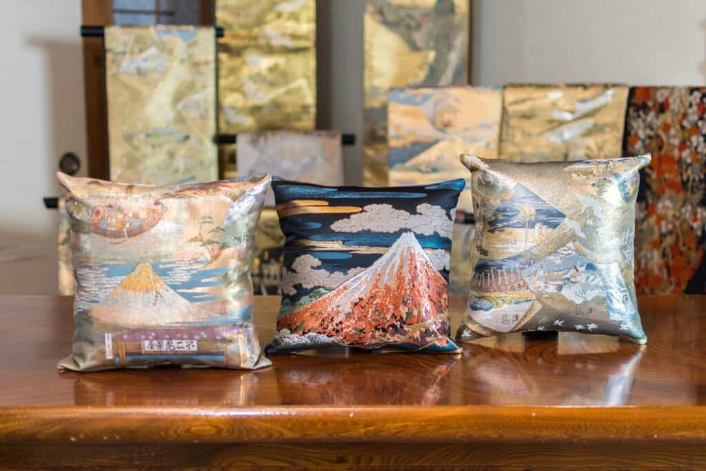 Vintage obi depicting scenes of Hiroshige Utagawa's 53 Stations of the Tokaido reconstructed into cushions