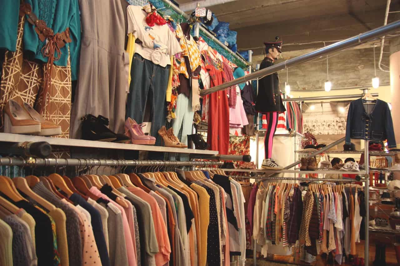 rails of vintage clothing in a thrift store