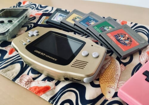 An assortment of region-free Game Boy handhelds and Pokemon titles