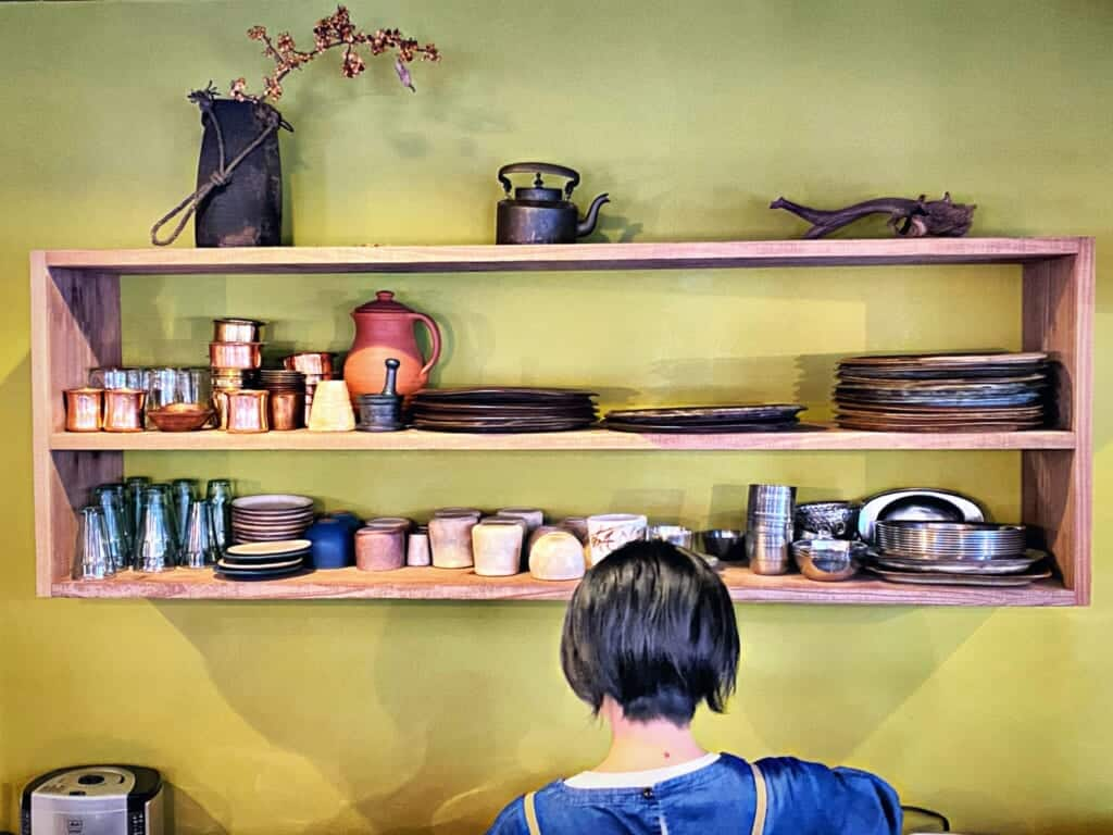 In the kitchen: tableware on a wooden shelf