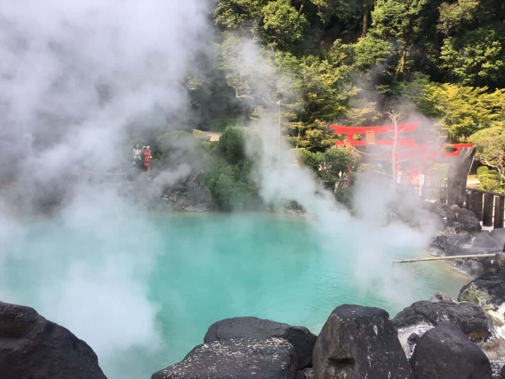 The blue water and red torii of the Umi Jigoku in Beppu