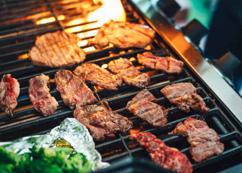 Some grilled meat in a barbecue