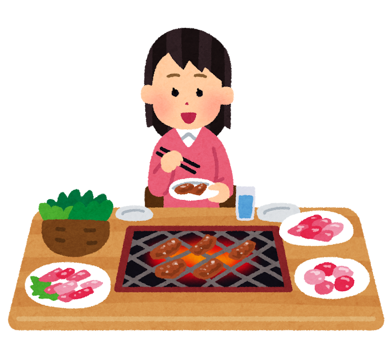 A girl eating by herself in a yakiniku restaurant