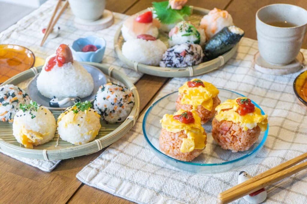 Many different types of onigiri on a table