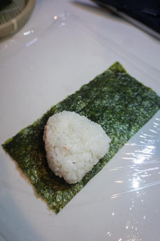 Starting to wrap the onigiri