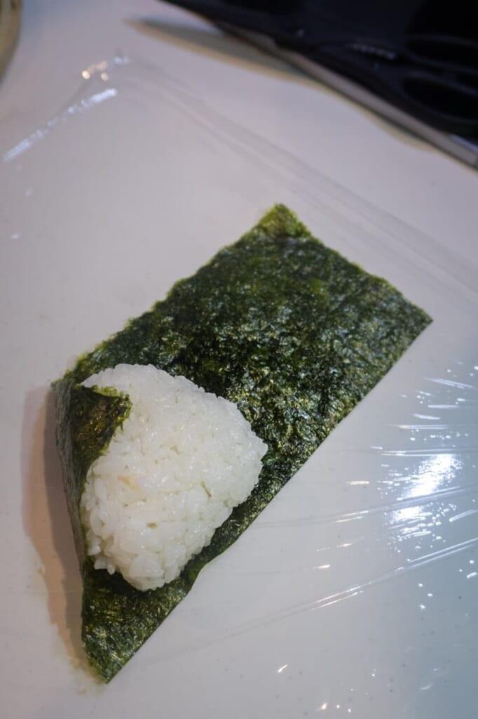 Second step to wrap the onigiri