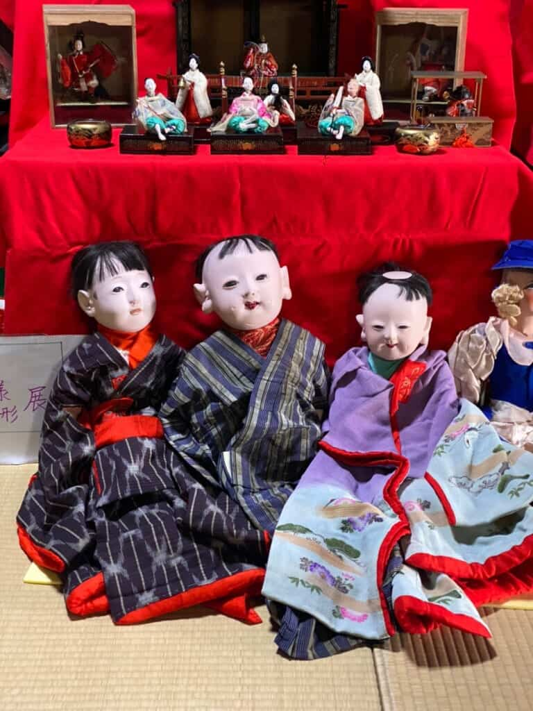 Closeup of the rare Tenjin dolls made out of Paulownia wood and lacquer powder, made by Minoru Aono, in a Traditional Japanese house on the Tokaido Road