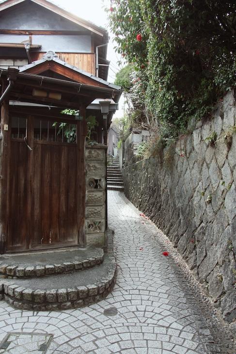 stone tiled sidewalks in quaint Japanese street of Onomichi