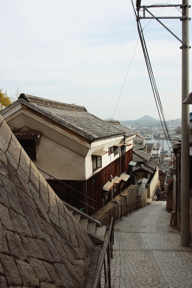 A steep hill in Onomichi with views of its preserved buildings and houses