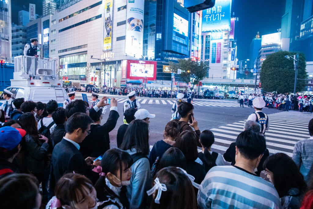 Police controlling the crowds in Shibuya