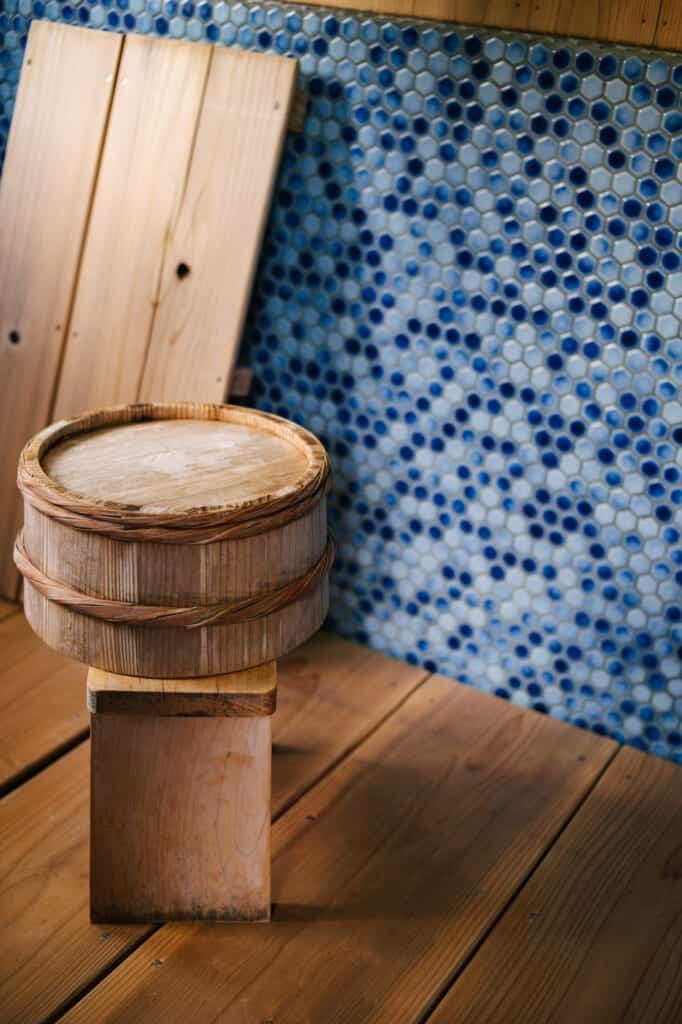 wooden bucket used for bathing in Japanese guesthouse on ojika island