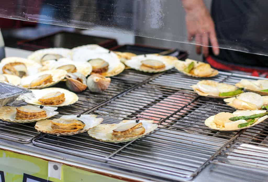 Scallops being grilled at Otatomari Swamp on Rishiri Island, Hokkaido