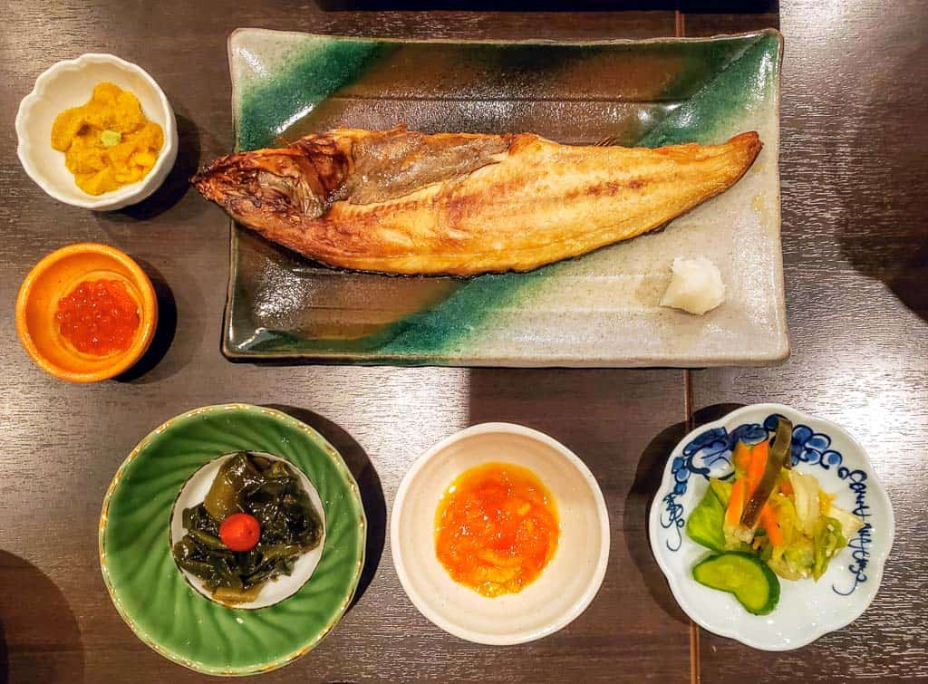 Grilled local mackerel, fresh sea urchin, and simmering seafood nabe pots at Rera Mosir on Rishiri Island, Hokkaido
