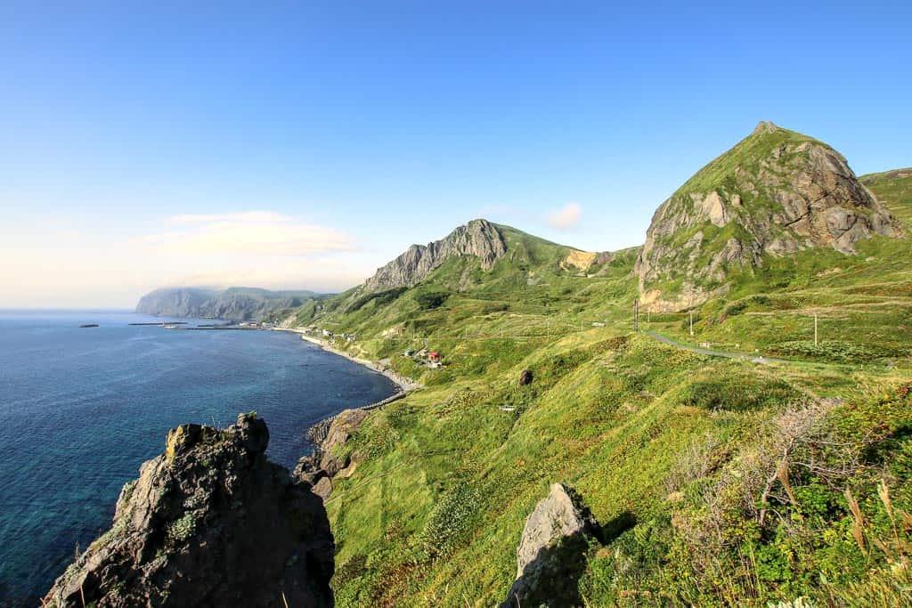 Ocean and hillside views along Momoiwa Observatory Point while hiking in Rebun, Hokkaido
