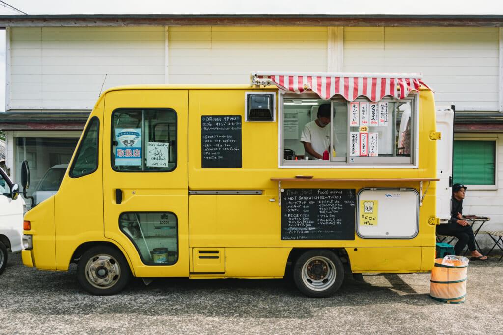 Bright yellow food truck of Flourjams on Ojika Island