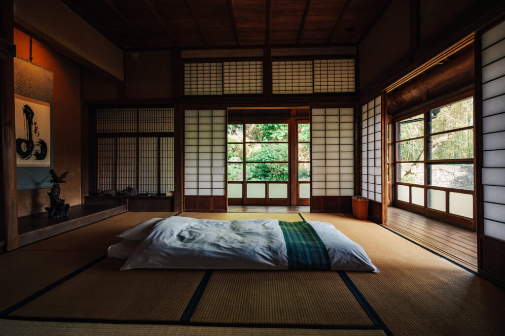 Tatami room sleeping area at Ichie-an, a restored kominka on Ojika Island