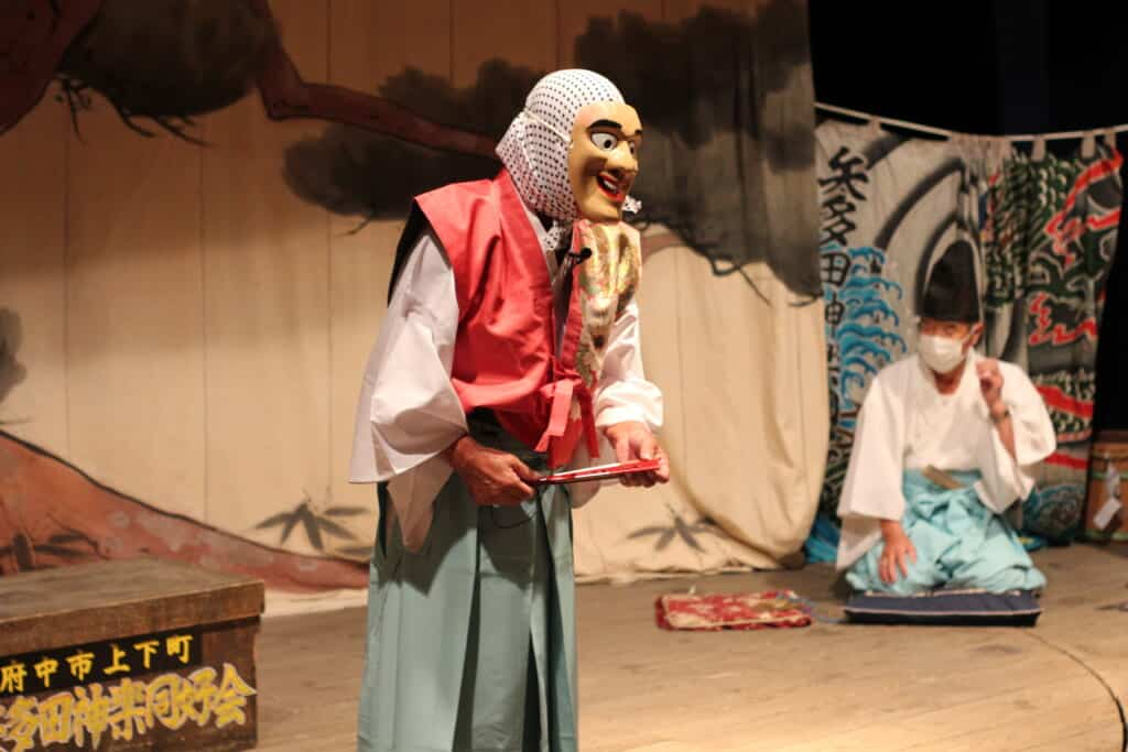 Actor wearing a mask during a kagura performance in Joge, Hiroshima Prefecture