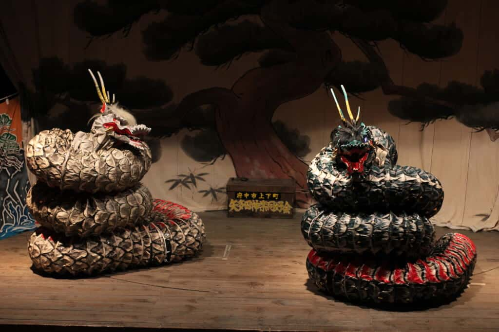Japanese kagura theater dragons on a wooden stage