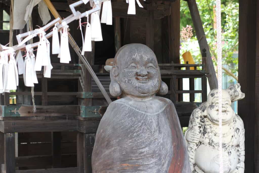 Wooden Buddhist statues in Japanese countryside