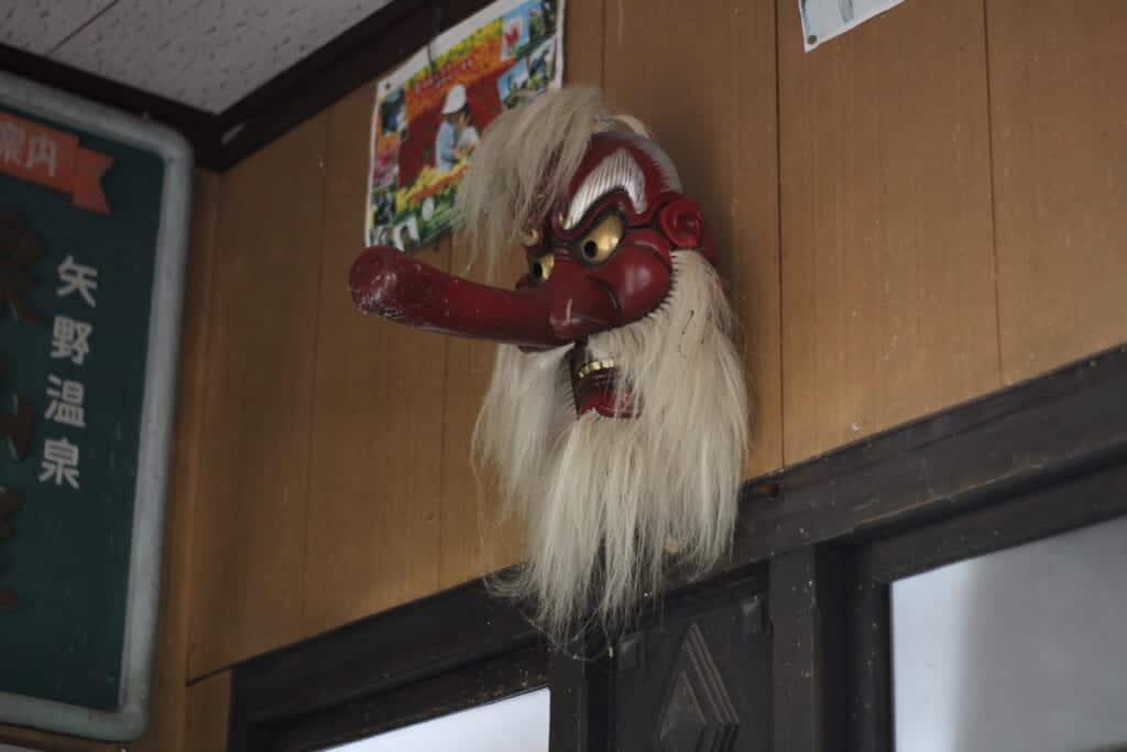 Tengu mask displayed in a Japanese restaurant