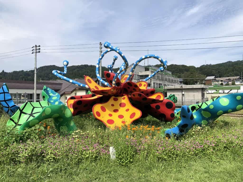Colourful artwork Tsumari in Bloom, by Yayoi Kusama