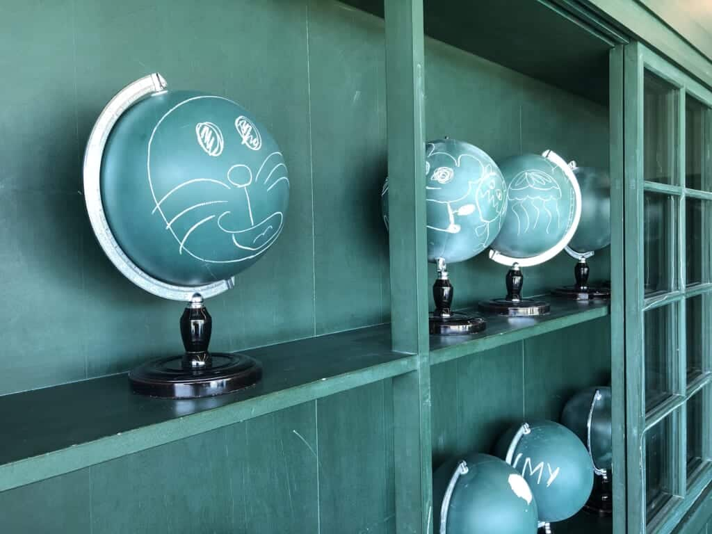 Blue globes with Doraemon's face drawn with white chalk