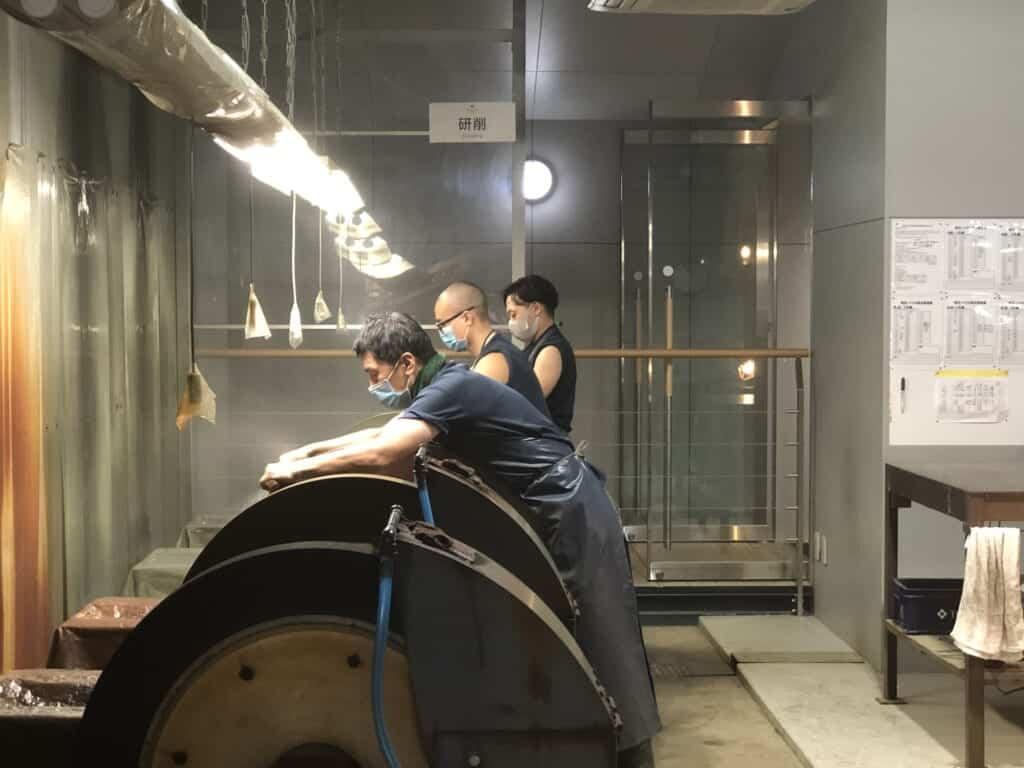 Workers inside a knife factory in Japan