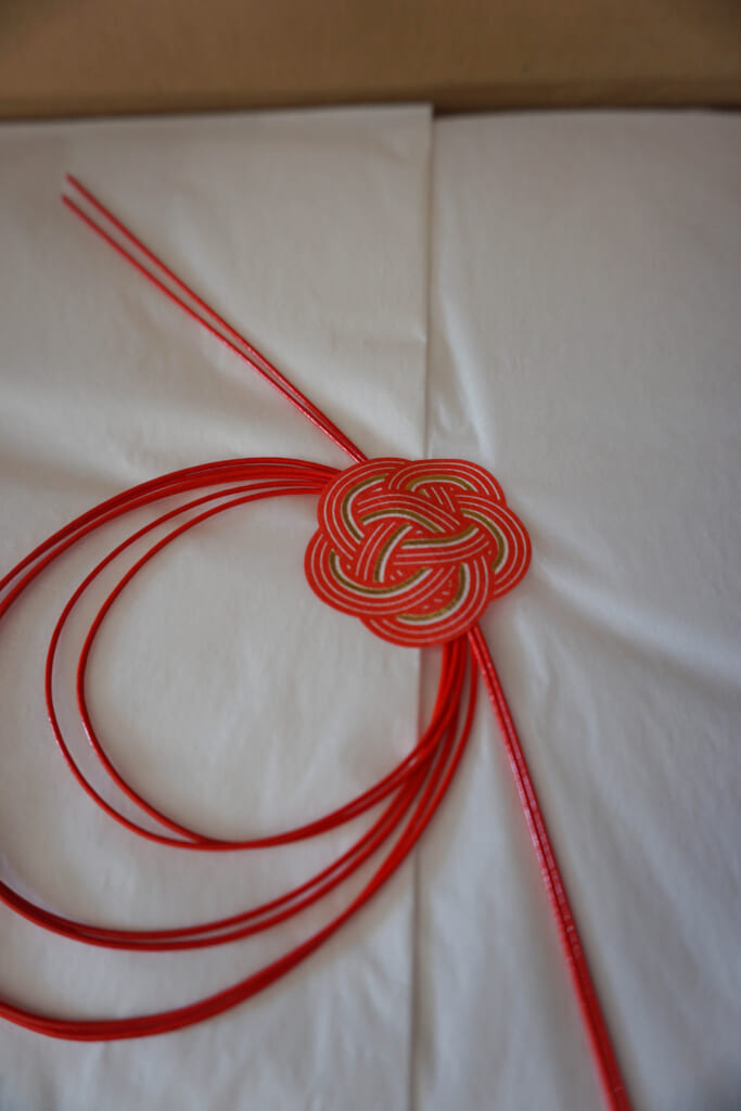 The plum knot on one of the wrapping papers