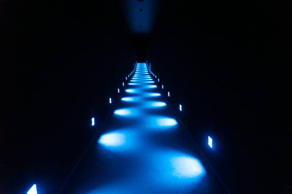 corridor with blue lights at teamlab planets