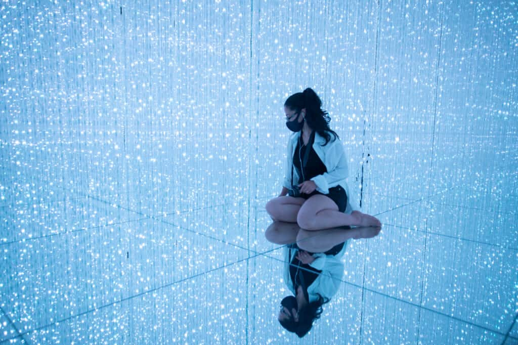 girl and her reflection between crystals of light