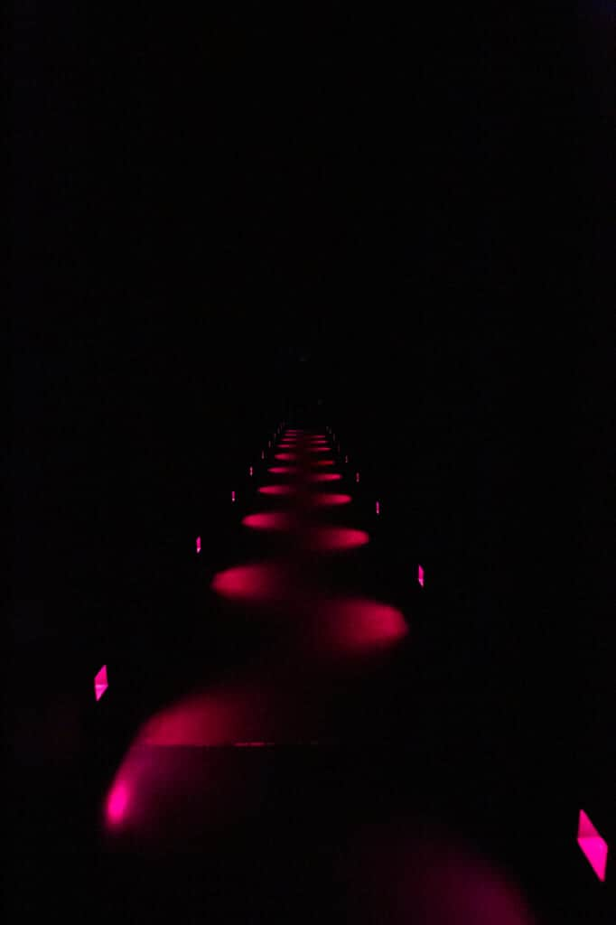 corridor with red lights at teamlab planets
