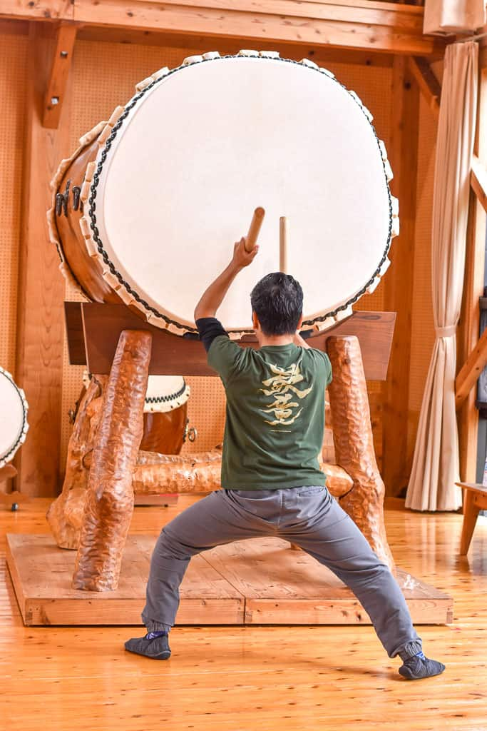 Man beating drum on taiko on Sado Island in Niigata