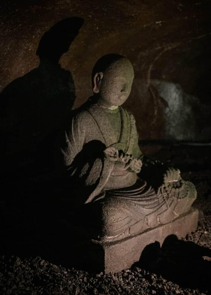 Stone Statues in Interior of Iwaya Cave on Enoshima Island
