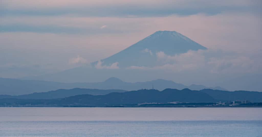 a view of mt. fuji through clouds from enoshima island