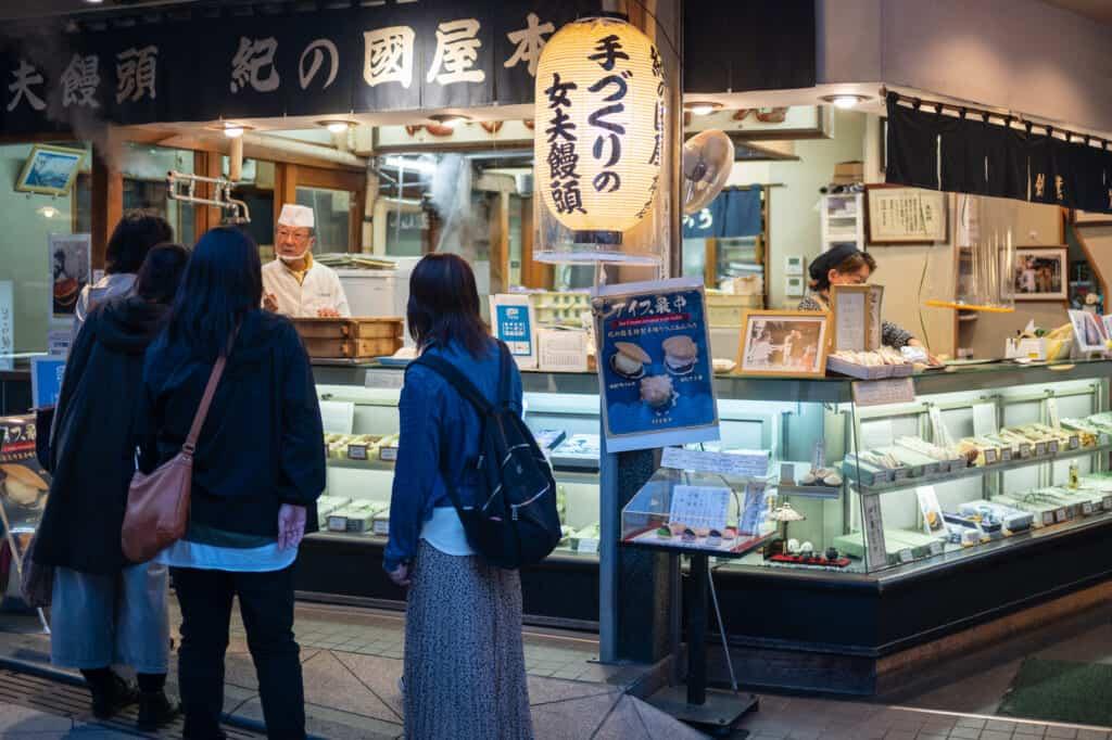 shoppers at a shop on bentaizen nakamise street enoshima island