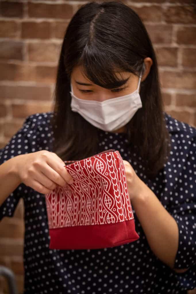 Minako checking their textile articles