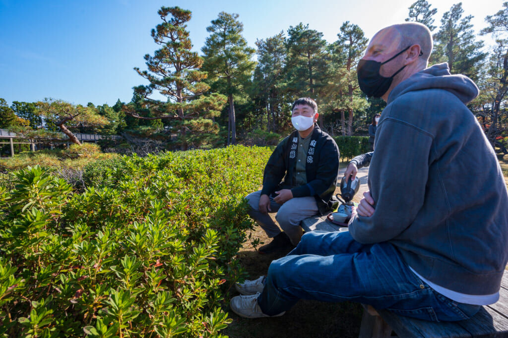 Staying safe with masks while enjoying tea in a Japanese Garden  near Kyoto