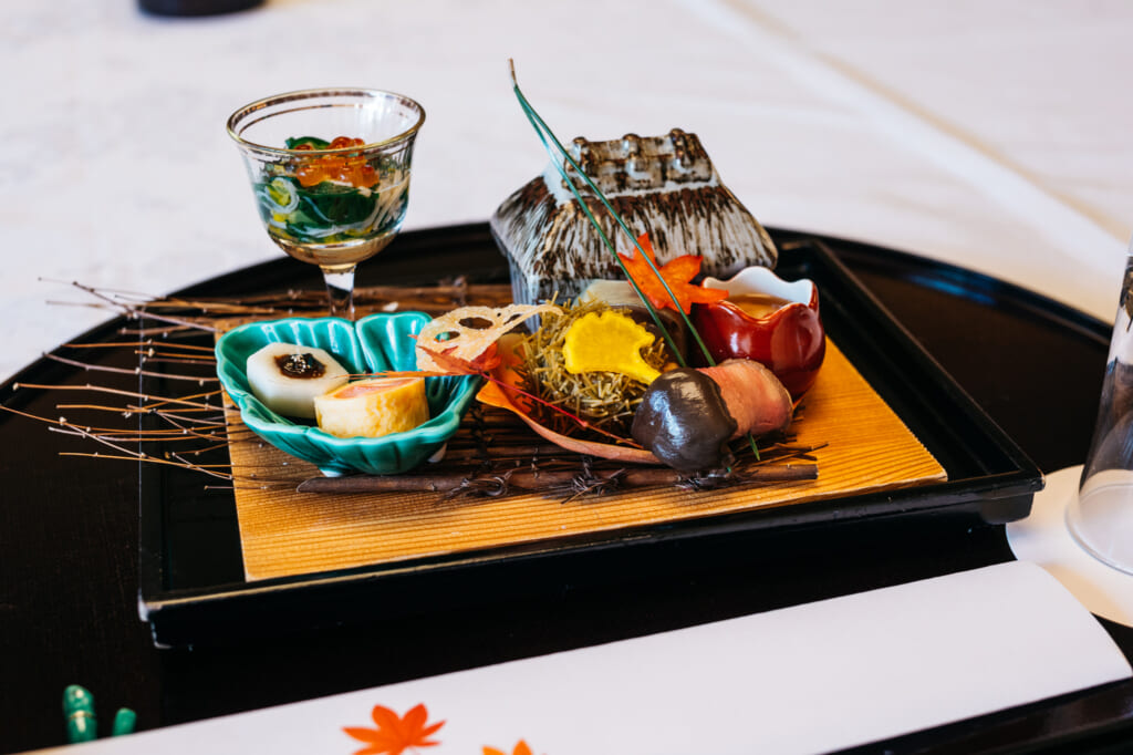 Traditional Japanese cuisine with autumn theme in restaurant near Kyoto