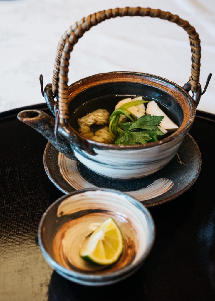 Japanese broth and matsutake mushroom dish