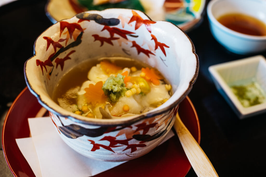 Japanese simmered meal with autumn themed ceramics in a restaurant near kyoto