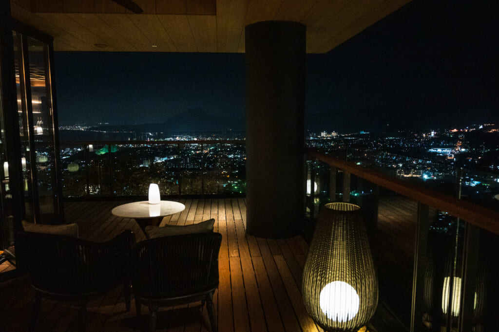 night time view of beppu overlooking balcony