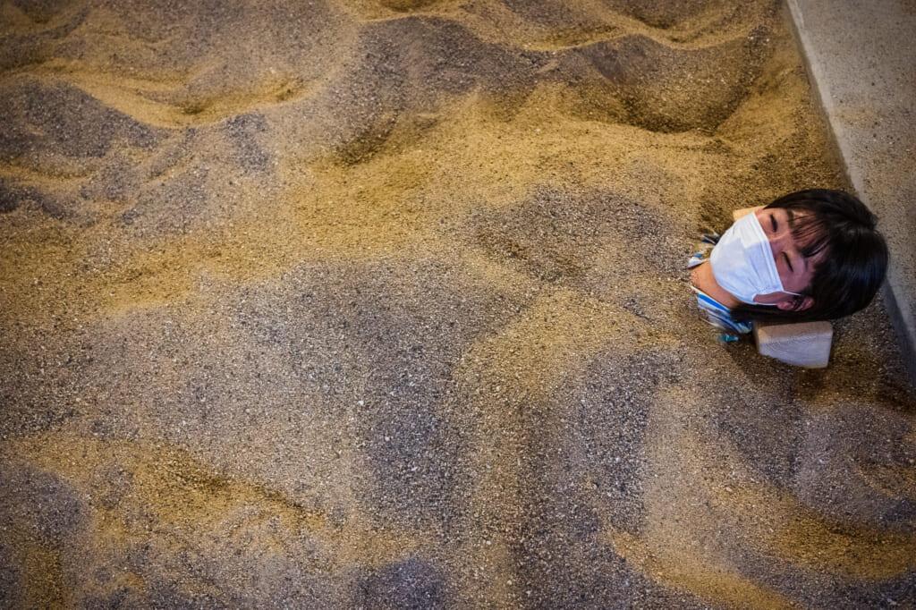 woman in beppu sand bath