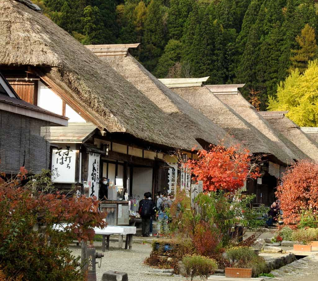 thatched roof traditional houses along the Ouchi-juku post town in japan